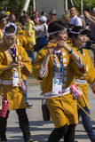 Musicians in yellow dresses on the Japanese traditional parade on EXPO 2015 Royalty Free Stock Image