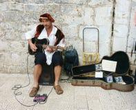 Musicien de rue dans Dubrovnik Photos stock