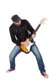 Musicien jouant la guitare électrique avec enthousiasme D'isolement sur le blanc image stock