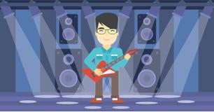 Musicien jouant la guitare électrique Photographie stock libre de droits