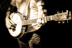 Musicien jouant le banjo photo stock