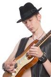 Musicien jouant sur la guitare électrique Photo stock