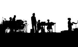 Musiciens de groupe de rock jouant sur des iPads Photos libres de droits