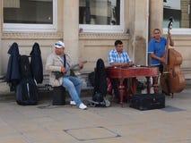 Musiciens de rue dans le cheltnam R-U Photos stock