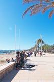 Musiciens jouant par la plage Photos stock