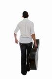 Musicista che cammina via Fotografie Stock Libere da Diritti