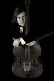 Musicista del contrabass di fantasticheria nella seppia Fotografie Stock