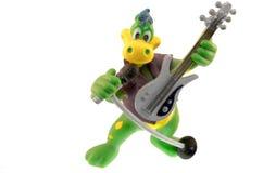 Musicista del dinosauro Immagine Stock