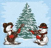 Musicisti dei pupazzi di neve ad un albero di Natale Immagine Stock