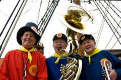 Musicisti di fascia di Frendship sulla scheda di bontà Fotografia Stock