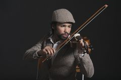 Musicus die een viool spelen Royalty-vrije Stock Afbeeldingen