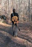 Musicus in het Hout Royalty-vrije Stock Afbeelding