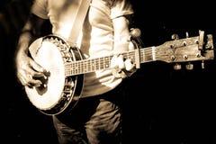 Musicus het spelen banjo stock foto