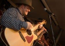 Musicus met een gitaar. royalty-vrije stock afbeeldingen