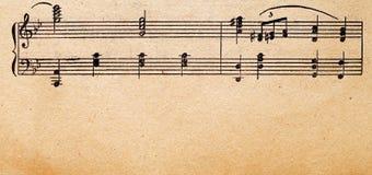 musik bemärker det gammala paper arket Royaltyfria Bilder