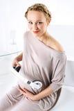 Musik in der Schwangerschaft Lizenzfreies Stockfoto
