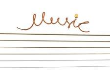 Musik die Aufschrift einer Schnur. Stockbild