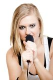 Musik Mädchensängermusiker, der zum Mikrofon singt Stockfoto