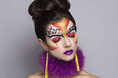 Musik make up art. Person beautiful woman listening songs. Painted face bright art make up bodyart faceart, lady young beautiful girl. Colorful music equalizer Royalty Free Stock Images