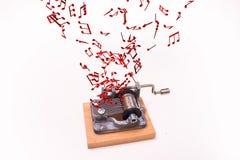 Musik merkt Fliegen aus Spieluhr heraus Lizenzfreie Stockbilder
