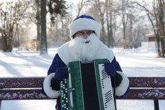 Musik munspel, ferie, vinter, maskeradkläder, jul Arkivbilder