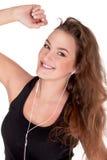 Musik och underhålla för ung kvinna lyssnande Fotografering för Bildbyråer