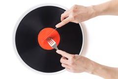 Musikalisk platta på den äta middag plattan arkivfoton