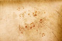 Musikanmerkungen über antiken Hintergrund Stockbild