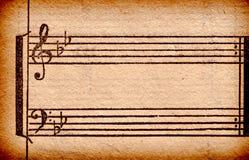 Musikanmerkungen über altes Papierblatt Stockbilder