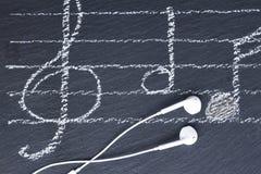 Musikanmerkungen mit Kopfhörern Lizenzfreies Stockfoto