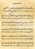 Musikanmerkungsblatt mit schwieriger Melodie auf altem Papier Stockbild