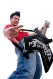 Musiker mit Gitarre Felsenzeichen gestikulierend Lizenzfreie Stockbilder