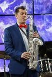 Musiker With Saxophone royaltyfria bilder