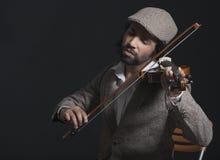 Musiker som spelar en fiol Royaltyfri Bild