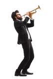 Musiker som spelar en trumpet arkivbilder