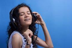 Musique de écoute Photographie stock libre de droits