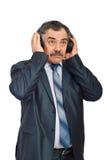 Musique de écoute d'homme d'affaires mûres Photos libres de droits