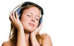 Musique de écoute de belle fille Image libre de droits