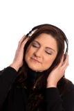 Musique de écoute de femmes photo libre de droits