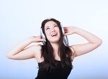 musique de écoute de fille à Photographie stock