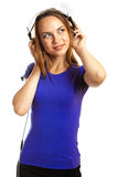 Musique de écoute de jeunes femmes Photo stock