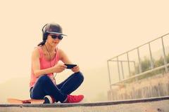 Musique de écoute de planchiste photographie stock libre de droits