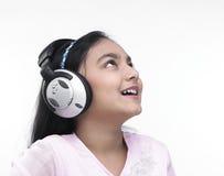 musique de écoute de fille à Image stock