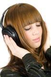 musique de écoute de fille Photographie stock libre de droits