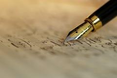 Musique de feuille et stylo-plume Photo libre de droits