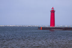 Muskegon Pier Lighthouse. A red lighthouse at the end of a pier on Lake Michigan Royalty Free Stock Photos