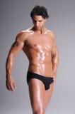 Muskel-Mann in den Schriftsätzen Stockfotos