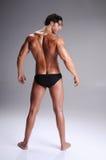 Muskel-Mann in den Schriftsätzen Lizenzfreies Stockbild