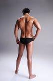 Muskel-Mann in den Schriftsätzen Stockbild