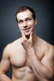 Muskeln oder Gehirn? Muskulöses Manndenken Lizenzfreies Stockbild